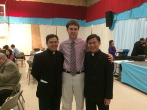 Truc Vu, Precious Blood Volunteer Ryan Cornelissen, and Loi Huu