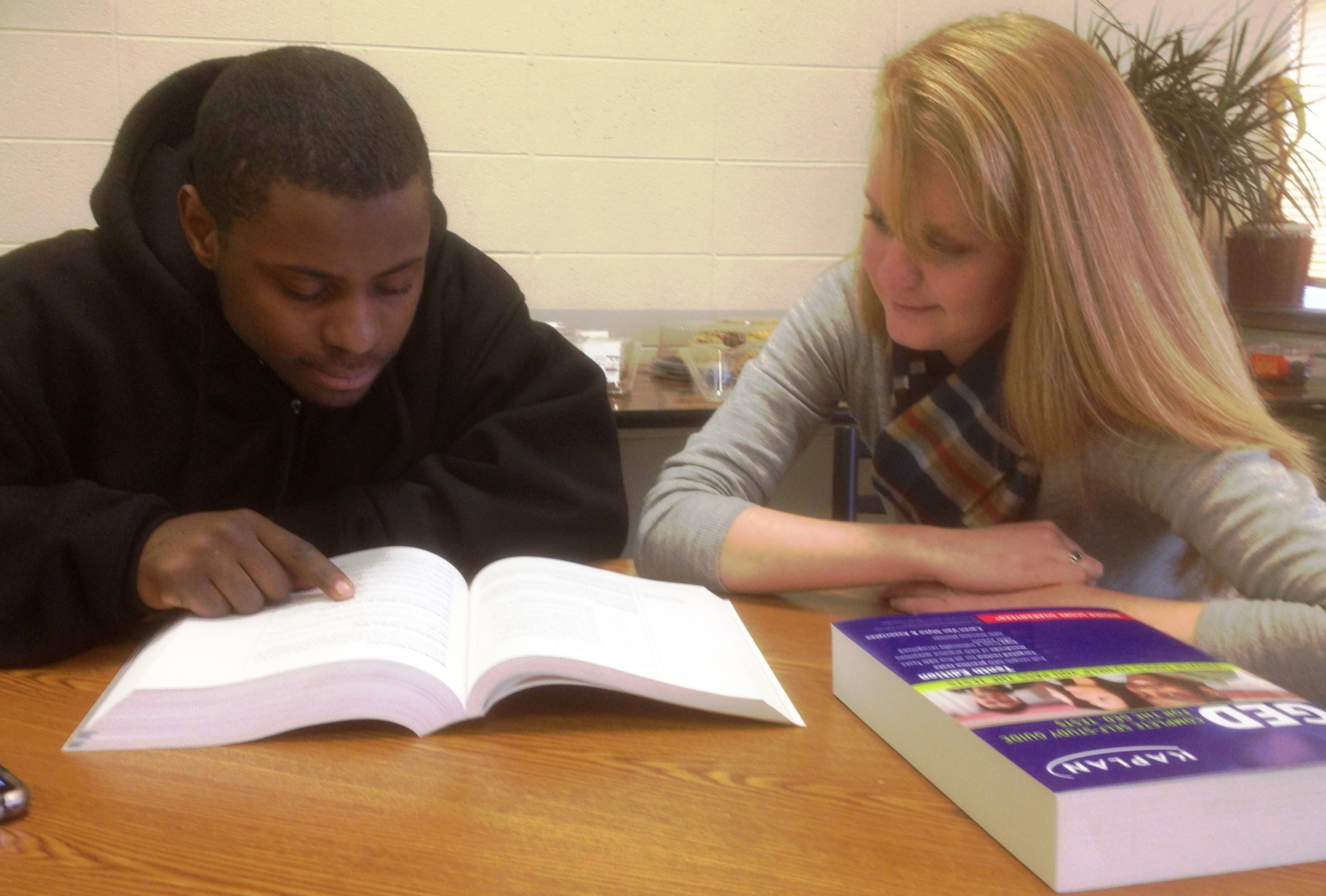 Volunteer tutoring student at Precious Blood Ministry of Reconciliation, Chicago.