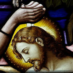 Stained glass image of Baptism of the Lord