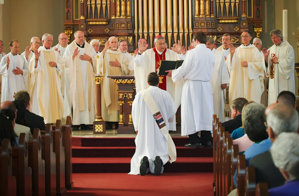 Bishop Joe Charron and Missionaries of the Precious Blood bless Mark Yates during his ordination