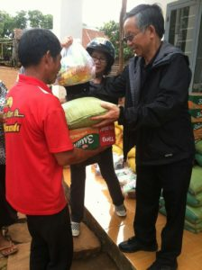 Fr. Nhan delivers food to a leper in Vietnam
