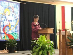 Kansas City Companion Becky McDonald lectors during morning prayer.