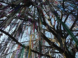 beads hanging from tree